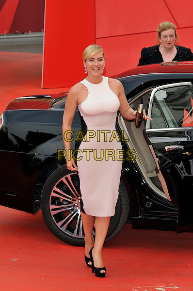 Kate Winslet.'Mildred Pierce' screening arrivals.Venice Film Festival, Italy 2nd Septembert 2011.full length white sleeveless dress car platform peep toe shoes.CAP/PL.©Phil Loftus/Capital Pictures.