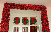 """The 2016 White House Christmas decorations are previewed for the press at the White House in Washington, DC on Tuesday, November 29, 2016. Pictured are the decorations around the doors of the East Visitor Entrance. The first lady's office released the following statement to describe those decorations, """"This year's holiday theme, 'The Gift of the Holidays,' reflects on not only the joy of giving and receiving, but also the true gifts of life, such as service, friends and family, education, and good health, as we celebrate the holiday season.""""<br /> Credit: Ron Sachs / CNP"""