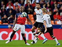 5th November 2019; Mestalla, Valencia, Spain; UEFA Champions League Football,Valencia versus Lille; Victor Osimhen of Lille controls the ball challenged by Daniel Wass and Ezequiel Garay of Valencia CF - Editorial Use