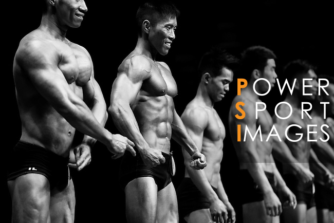 A bodybuilder competes in the South China Men's Athletic Physique below 170cm category during the 2016 Hong Kong Bodybuilding Championships on 12 June 2016 at Queen Elizabeth Stadium, Hong Kong, China. Photo by Victor Fraile / Power Sport Images