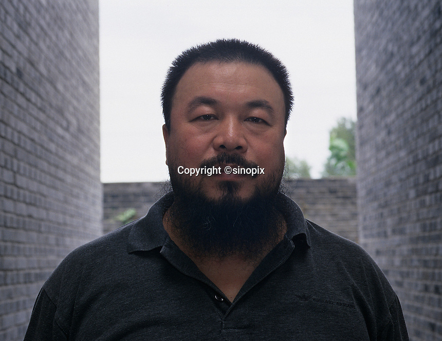 Ai Weiwei, Chinese contemporary artist, poses with his work in his studio in Beijing, China. <br /> 25 May 2006