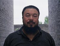 Ai Weiwei, Chinese contemporary artist, poses with his work in his studio in Beijing, China. <br />