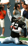 Cowboys/Raiders (9/27/98)        HOUCHRON CAPTION (09/28/1998):    Oakland safety Eric Turner celebrates after intercepting an end-zone pass that ended Dallas' hopes for comeback late in Sunday's game.