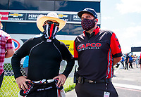 Jul 11, 2020; Clermont, Indiana, USA; NHRA top fuel driver Steve Torrence (left) with crew chief Bobby Lagana during qualifying for the E3 Spark Plugs Nationals at Lucas Oil Raceway. This is the first race back for NHRA since the start of the COVID-19 global pandemic. Mandatory Credit: Mark J. Rebilas-USA TODAY Sports