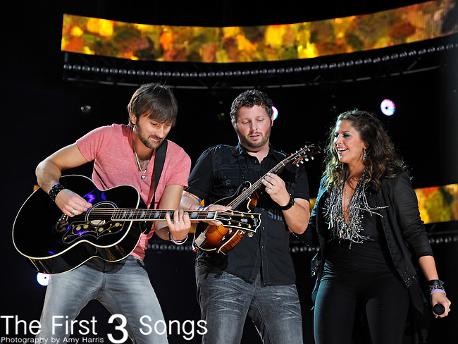 Dave Haywood, Charles Kelley, and Hillary Scott of Lady Antebellum perform at LP Field during the 2012 CMA Music Festival on June 07, 2011 in Nashville, Tennessee.