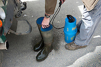 Disinfecting wellington boots before visiting a farm.