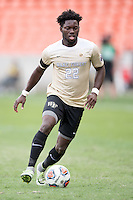 Houston, TX -  Sunday, December 11, 2016: Ema Twumasi (22) of the Wake Forest Demon Deacons brings the ball up the field in the first half against the Stanford Cardinal at the  NCAA Men's Soccer Fnals at BBVA Compass Stadium.