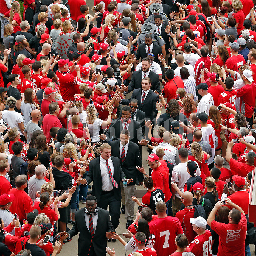 Ohio State Buckeyes walk into Ohio Stadium before their game against Northern Illinois Huskies at Ohio Stadium on September 19, 2015.  (Dispatch photo by Kyle Robertson)