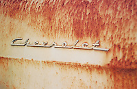 Photo of Chevy logo on old car.