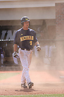 Nick Urban #9  of the University of Michigan Wolverines after sliding and scoring a run against the Coastal Carolina University Chanticleers at the Carvelle Resort Classic Tournament held at Watson Stadium at Vrooman Field in Conway, SC on March 13, 2010. Photo by Robert Gurganus/Four Seam Images