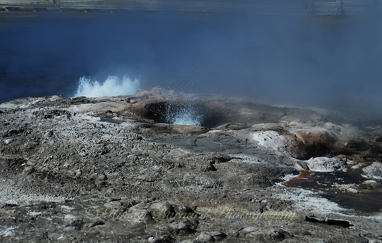 Colorful geyser pools in Yellowtone National Park