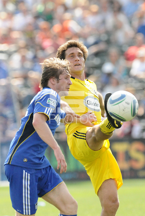 Guillermo Barros Schelotto (yellow), Jonathan Leathers...Kansas City Wizards were defeated 1-0 by Columbus Crew at Community America Ballpark, Kansas City, Kansas...Kansas City Wizards were defeated 1-0 by Columbus Crew at Community America Ballpark, Kansas City, Kansas.