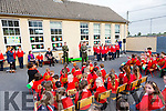 Irish defence forces  Lt Denis Sheahan with help from Kelly Meehan 6th class to read out part of the proclamation at Scoil Mhuire Gan Smal,  Lixnaw, when he visited the school on Thursday to present the Irish Tri Colour and proclamation