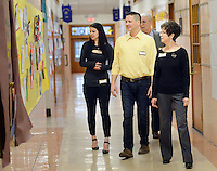 From left, Jaclyn Reiman, Dominic Parzanese (Class of 1994) of Upper Black Eddy, Pennsylvania, Donald Parzanese (Class of 1959) and Eileen Parzanese (Class of 1960) of Warrington, Pennsylvania tour the school during Our Lady of Mt. Carmel School's 140th Anniversary celebration Saturday, April 9, 2016 at the school in Doylestown, Pennsylvania.  (Photo by William Thomas Cain)