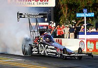 Nov 7, 2013; Pomona, CA, USA; NHRA top fuel dragster driver Spencer Massey during qualifying for the Auto Club Finals at Auto Club Raceway at Pomona. Mandatory Credit: Mark J. Rebilas-