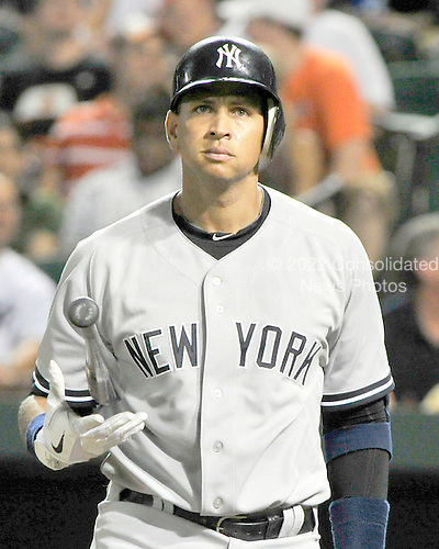 New York Yankees third baseman Alex Rodriguez (13) flips his bat in frustration in the eighth inning against the Baltimore Orioles at Oriole Park at Camden Yards in Baltimore, MD on Friday, August 26, 2011.  The Orioles won the game 12 - 5..Credit: Ron Sachs / CNP.(RESTRICTION: NO New York or New Jersey Newspapers or newspapers within a 75 mile radius of New York City)
