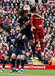 Nathan Ake of Bournemouth challenges Alex Oxlade-Chamberlain of Liverpool during the Premier League match at Anfield, Liverpool. Picture date: 7th March 2020. Picture credit should read: Darren Staples/Sportimage
