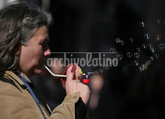 A woman sells a bubble puppet in  San Telmo square, one of the more interesting historical areas of Buenos Aires.