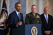 United States President Barack Obama (L) speaks on the Orlando shooting at the Treasury Department while Chairman of the Joint Chiefs of Staff General Joseph Dunford (C) and Director of National Intelligence James Clapper (R) look on in Washington, DC, USA, 14 June 2016. Obama used the opportunity to directly attacked Donald Trump's proposal to ban Muslims from entering the United States<br /> Credit: Jim LoScalzo / Pool via CNP