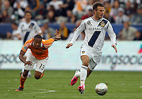 CARSON, CA - DECEMBER 01, 2012:   David Beckham (23) of the Los Angeles Galaxy races away from Ricardo Clark (13) of the Houston Dynamo during the 2012 MLS Cup at the Home Depot Center, in Carson, California on December 01, 2012. The Galaxy won 3-1.