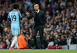 Manchester City Manager Pep Guardiola gives instructions to Leroy Sane of Manchester City during the English Premier League match at The Etihad Stadium, Manchester. Picture date: April 27th, 2016. Photo credit should read: Lynne Cameron/Sportimage