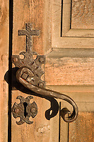 Intricate door handle design at Mission Concepcion, or Mission Nuestra Senora de la Purisima Concepcion de Acuna, a church built by Franciscans in 1755 in San Antonio, Texas and part of the San Antonio Mission National Historical Park.