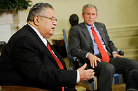 Washington, DC - June 25, 2008 -- United States President George W. Bush listens as the President of Iraq Jalal Talabani makes comments to the news media after a meeting in the Oval Office of the White House in Washington, D.C. USA 25 June 2008. A roadside bombing killed three U.S. soldiers yesterday in northern Iraq, bringing the number of American troop deaths this week in the country to seven.<br /> CAP/MPI/CNP/RS<br /> &copy;RS/CNP/MPI/Capital Pictures