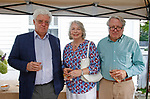 Washington, CT- 081217MK24 (from left) John Beyer, Camille nad David Gillespie gathered at the St. John's Surf and or Turf Shore Dinner and wine tasting at the St. John's Church Parish House. The event concluded the Food Fest fund raiser that helps to support Emergency Fund that provides assistance to locals faced with urgent financial needs for food, fuel and medicines. Michael Kabelka / Republican-American
