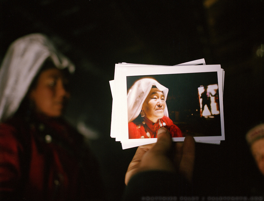 Pictures of Afghan Kyrgyz holding pictures of Matthieu Paley given as a present.