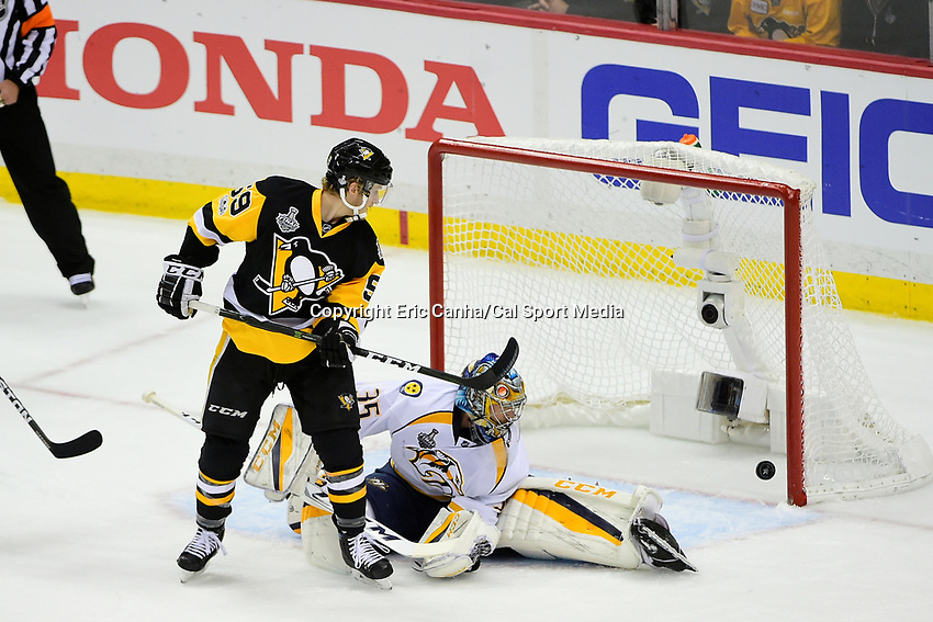 May 29, 2017: Nashville Predators goalie Pekka Rinne (35) and Pittsburgh Penguins center Jake Guentzel (59) watch the puck cross the goal line during game one of the National Hockey League Stanley Cup Finals between the Nashville Predators  and the Pittsburgh Penguins, held at PPG Paints Arena, in Pittsburgh, PA.   Eric Canha/CSM