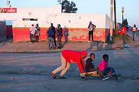 NDEVANA, SOUTH AFRICA MAY 6: Children play outside a local bar on May 6, 2018 in Ndevana, a rural village in Eastern Cape Province in South Africa. Ndevana has about 40.000 residents but no proper facilities like a shop or hospital. The unemployment rate is huge (about 80-90%) in this forgotten rural area about 50 km from east London, South Africa. (Photo by: Per-Anders Pettersson/Getty Images)