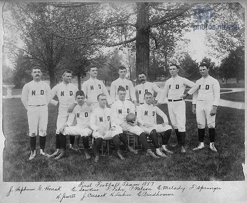GMLS 4/02:  Football Team Photo, 1887 (1888).<br /> Standing:  Joe L. Hepburn, George Houck, Edward A. Hawkins, Frank Fehr, Patrick Nelson, Gene Melady, Frank Springer<br /> Seated:  Harry M. Jewett, Joe F. Cusack, Captain Henry B. Luhn, Edward Prudhomme<br /> [The individuals in this photo are those who played in the April 1888 football game vs. Michigan.  Hepburn, Melady, and Prudehomme did not play in the 1887 game.  Additionally, the trees have leaves, which means this photo was probably taken in the spring of 1888, not the autumn of 1887.  In fact, the May 19, 1888 issue of Scholastic notes &quot;The special football eleven and several baseball nines were photographed on Thursday [May 17, 1888].&quot;]  Image from the University of Notre Dame Archives.