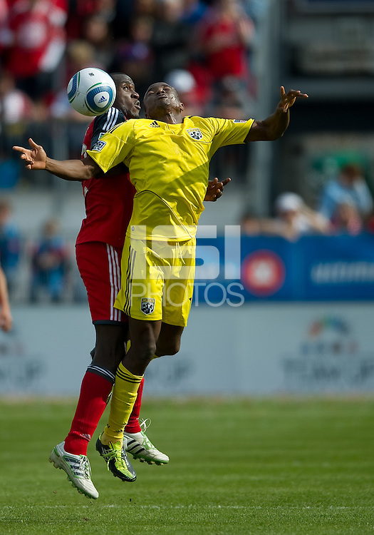 23 April 2011: Columbus Crew midfielder Dilly Duka #11 and Toronto FC midfielder Tony Tchani #22 in action during a game between the Columbus Crew and the Toronto FC at BMO Field in Toronto, Ontario Canada..The game ended in a 1-1 draw.