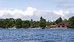 In addition to the Siladen Resort and Spa, Siladen Island's one small village has one guest house/hotel, which shares the village's fabulous white sand beach.  (Siladen Island, in the Bunaken National Park off North Sulawesi, Indonesia.)