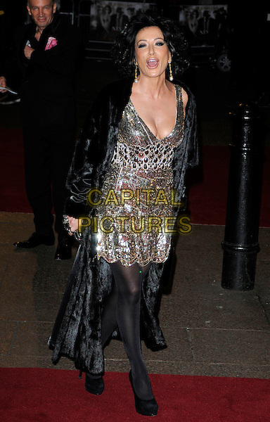 NANCY DELL'OLIO.Attending the World Premiere of the film 'NINE' held at the Odeon cinema Leicester Square, London, England, UK,  3rd December 2009..full length black coat fur gold sequined sequin cleavage low cut platform shoes tights clutch bag dress embellished mouth open funny .CAP/CAN.©Can Nguyen/Capital Pictures.