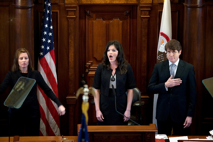 A week after the Illinois House voted to impeach him, Gov. Rod Blagojevich led the senate inauguration ceremony at the Illinois State Capitol in Springfield, Ill. Molly Durand, center, sings the national anthem at the session's opening.