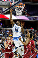 Washington, DC - MAR 10, 2018: Rhode Island Rams forward Cyril Langevine (10) goes up for a lay up over Saint Joseph's Hawks guard Nick Robinson (5) during the semi final match up of the Atlantic 10 men's basketball championship between Saint Joseph's and Rhode Island at the Capital One Arena in Washington, DC. (Photo by Phil Peters/Media Images International)
