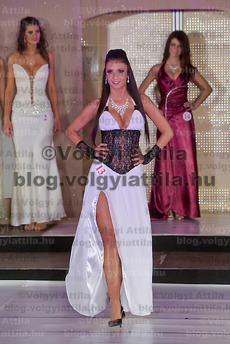 Betrix Schmuczer, participant of Miss Hungary beauty contest poses during the final of the beauty pegant held in Budapest, Hungary. Saturday, 19. December 2009. ATTILA VOLGYI