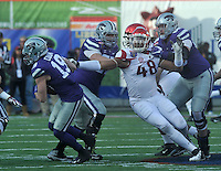 NWA Democrat-Gazette/MICHAEL WOODS • @NWAMICHAELW<br /> University of Arkansas defensive end Deatrich Wise Jr (48) puts the pressure on Kansas State quarterback Kody Cook   in the 2nd quarter of the Razorbacks 45-23 win over Kansas State in the 57th annual AutoZone Liberty Bowl January 2, 2016.
