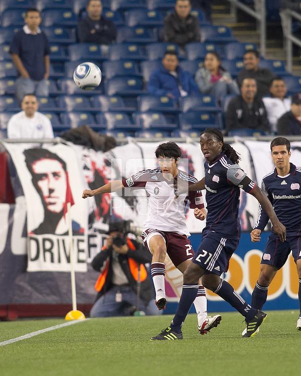 Colorado Rapids midfielder Kosuke Kimura (27) passes the ball as New England Revolution midfielder Shalrie Joseph (21) pressures. In a Major League Soccer (MLS) match, the New England Revolution tied the Colorado Rapids, 0-0, at Gillette Stadium on May 7, 2011.