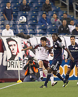 Colorado Rapids midfielder Kosuke Kimura (27) passes the ball as New England Revolution midfielder Shalrie Joseph (21) pressures. In a Major League Soccer (MLS) match, the New England Revolution tied the Colorado Rapids, 0-0, at Gillette Stadium on May 7, 2011.