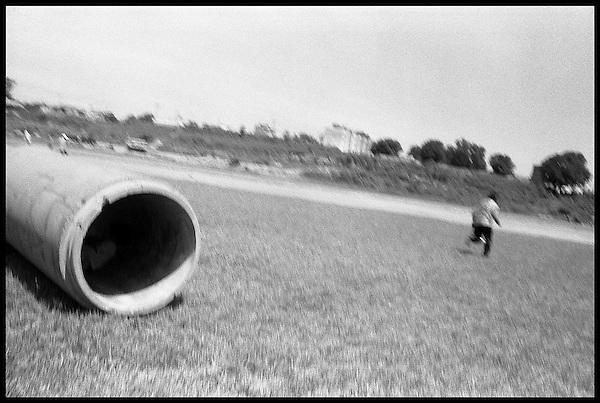 Boys play hide and go seek in abandoned sewage pipes spread around a soccer field in Puebla, Mexico. The water shortage in Oaxaca, a few hours south on the Atoyac River, is partly due to the industrial pollution in the river which starts at the factories in Puebla. What city water that exists in Oaxaca has become undrinkable even for the locals who must rely on bottled water most of the time....