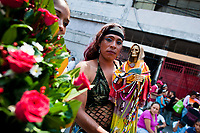 A Mexican transsexual, the Santa Muerte (Saint Death) follower, holds a sacred figurine during a religious pilgrimage to the shrine in Tepito, a dangerous neighborhood of Mexico City, Mexico, 1 May 2011. The religious cult of Santa Muerte is a syncretic fusion of Aztec death worship rituals and Catholic beliefs. Born in lower-class neighborhoods of Mexico City, it has always been closely associated with crime. In the past decades, original Santa Muerte's followers (such as prostitutes, pickpockets and street drug traffickers) have merged with thousands of ordinary Mexican Catholics. The Saint Death veneration, offering a spiritual way out of hardship in the modern society, has rapidly expanded. Although the Catholic Church considers the Santa Muerte's followers as devil worshippers, on the first day of every month, crowds of believers in Saint Death fill the streets of Tepito. Holding skeletal figurines of Holy Death clothed in a long robe, they pray for power healing, protection and favors and make petitions to 'La Santísima Muerte', who reputedly can make life-saving miracles.