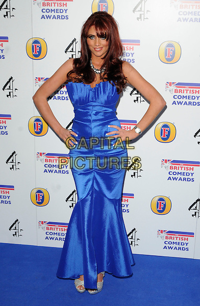 AMY CHILDS .from 'The Only Way Is Essex'.Attending the British Comedy Awards 2011at Indigo, The O2 Arena, London.England, UK, January 22nd, 2011..arrivals full length blue long maxi dress hands on hips strapless fishtail bustier .CAP/CAN.©Can Nguyen/Capital Pictures.