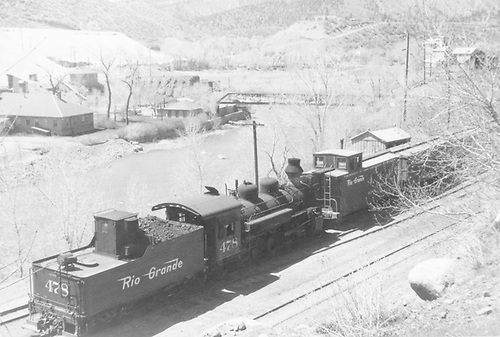 D&amp;RGW #478 switching caboose and box cars at end of train along Animas River in Durango.<br /> D&amp;RGW  Durango, CO  1964