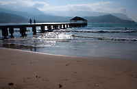 Strolling on the pier, surfing and swimming at Hanalei Beach Park on the North Shore of Kauai, with blue-tinged Na Pali in the background.