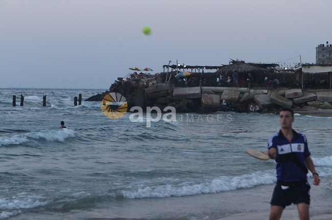 Palestinians take a dip in the sea as the sun sets over the Gaza City, on August 14, 2014.A fresh five-day ceasefire between Palestinian militants and Israel went into force early Thursday, agreed at the end of a three-day truce. Photo by Naaman Omar