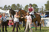 Flat Top (left) in winners circle with Bounding Cat, jockey Robbie Walsh, trainer Janet Elliot, and Allison Fulmer (center), Aiken Spring Races 2009.