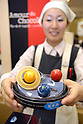 "An employee of Tokyo's Nihonbashi Takashimaya shows a box of chocolates. The department store currently holds a chocolate fair ""Amour du Chocolat!"" for Valentine's Day."