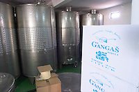 Stainless steel fermentation tanks in the winery. Box in the foreground with the name of the winery. Vita@I Vitaai Vitai Gangas Winery, Citluk, near Mostar. Federation Bosne i Hercegovine. Bosnia Herzegovina, Europe.